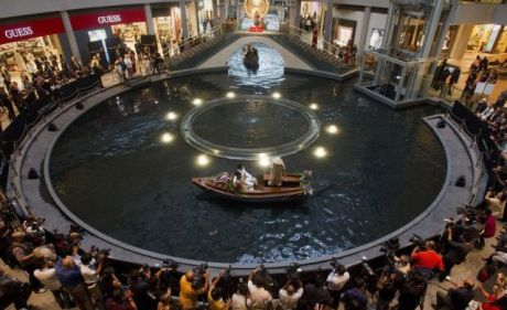 A newlywed couple takes a sampan ride on a canal inside a shopping centre at the Marina Bay Sands integrated resort in Singapore